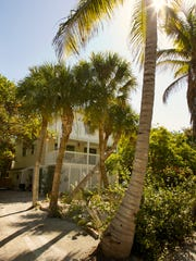 The White Pelican Drive home of Pam West is quaintly nestled among the island palms.