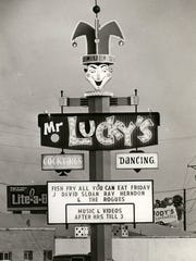THEN: For years, the sign for Mr. Lucky's nightclub