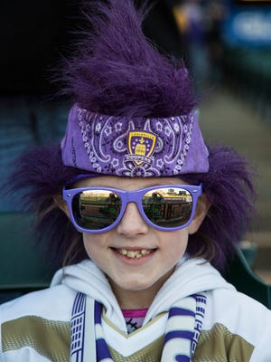 Alaina Daring, 8,  sports her best gear while waiting for the start of the Louisville City FC vs. Orlando City FC game at Louisville Slugger Field, April 9, 2016, in Louisville, Ky.