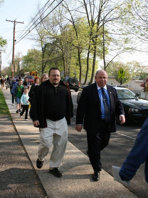 Parsippany Mayor James Barberio, right, leads a student walk during Earth Day in 2010.