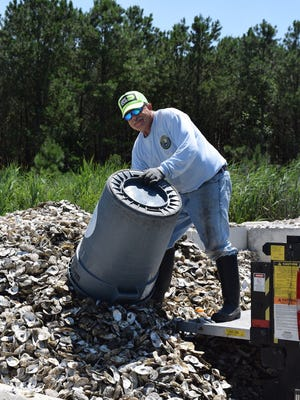 Dave Ritondo delivers oyster shells to a storage site for the Don't Chuck Your Shucks program. The shell recycling program is a partnership between the Center for the Inland Bays, the Nature Conservancy and local restaurants.