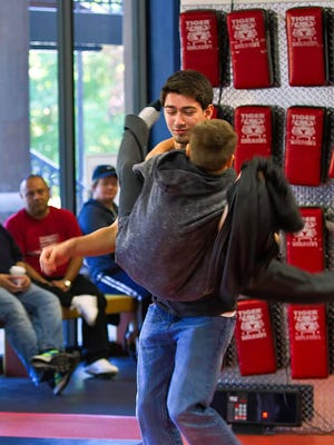 Michal Newman performs a flying scissor move on the bully, Joey Esposito.