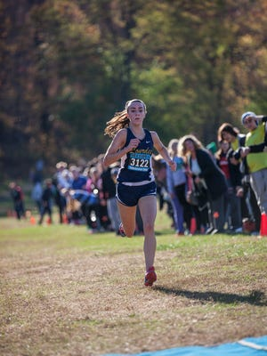 Caroline Timm of Our Lady of Lourdes takes first in the girls Class B race at the Section 1 Cross Country Championships at Bowdoin Park in Wappingers Falls, November 5, 2016.
