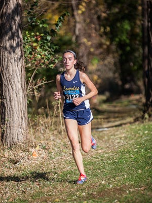 Caroline Timm of Our Lady of Lourdes takes first in the girls Class B race at the Section 1 Cross Country Championship at Bowdoin Park in Wappingers Falls, November 5, 2016.
