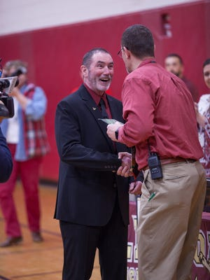 Arlington's head wrestling coach Fred Perry is recognized for his years of coaching before the start of his last match on Wednesday in Freedom Plains