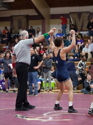 Peter Oliveto of Suffern faces off against Ray Cotto of John Jay Cross River for the 138lb class Section 1 Division 1 Championship title at Arlington High School in Arlington, February 11, 2017