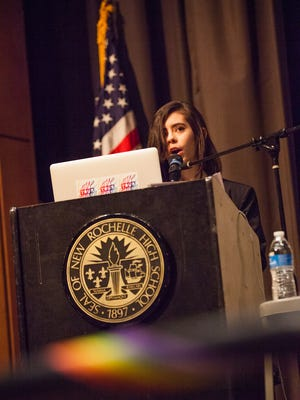 New Rochelle High School senior and Bezos Scholar Ana Acevedo addresses the auditorium during the one day event Unraveling Gender, an event she organized to provide a space for the community to discuss gender identity and expression at the high school in New Rochelle, March 25, 2017