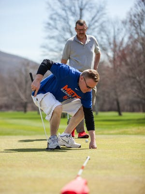 Fran Miller of Pawling, left, and John O'Hara of Garrison enjoy their first game of golf this year in the warm weather at the Fishkill Golf Course in Fishkill, April 10, 2017