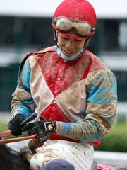 Jockey Jose L. Ortiz reacts after winning race 2 atop