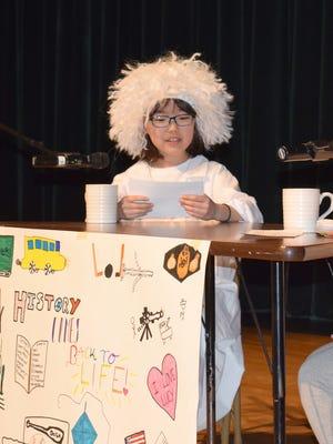 Sua Choi performs in African Road Elementary School's Historical Talk Show as Albert Einstein.