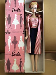 A Barbie Doll is displayed at the room of two Italian collectors and dealers at the Hyatt Regency in Los Angeles in 2006.