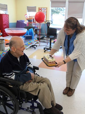"""Charles """"Chuck"""" Matheny receives a present on his 76th birthday in March."""