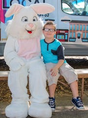 People have their picture taken with the Easter Bunny