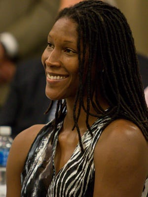 Michelle Snow, a Pensacola High School graduate and two-time WNBA All-Star, smiles as she is recognized during a press conference to announce a partnership between the Florida Sports Hall of Fame and Andrews Institue at the Andrews Performance & Research Pavilion in Gulf Breeze on Tuesday, May 15, 2018. She, along with other local sports icons Justin Gatlin and Roy Jones, Jr., will be inducted into the Florida Sports Hall of Fame on November 7 at the National Naval Aviation Museum on NAS Pensacola.
