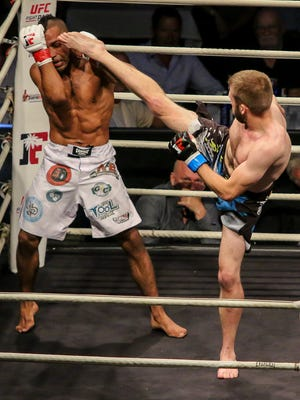Elvin Brito, red tape, takes on Jacob Kilburn at the Pensacola Bay Center on Saturday, June 2, 2018, during Island Fights 48. Kilburn won by unanimous decision.