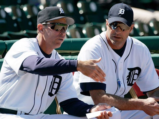 Detroit Tigers manager Alan Trammell, left, and bench