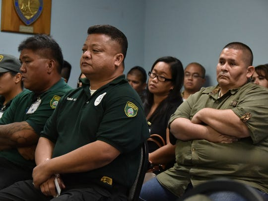 """Department of Corrections Lt. Antone Aguon, right, and other DOC employees listen on May 28, as the Civil Service Commission deliberates on department personnel promotions that were deemed improperly done. The commission voted to uphold its May 7 vote to void and nullify the promotions, despite testimony from DOC Director Jose San Agustin who asked the commission not to """"punish"""" the promoted employees."""