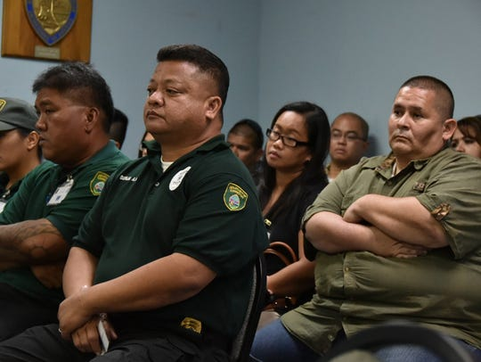 Department of Corrections Lt. Antone Aguon, right,