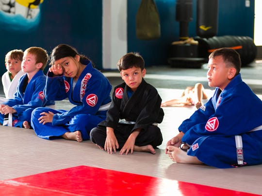 Second from right, Jeremiah Duenas listens to his instructor