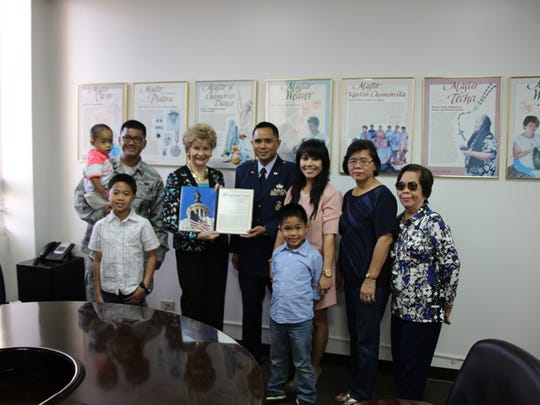 Guam Air National Guard (GUANG) Captain Alvin Alvarez, Operations Officer for the 254th Security Forces Squadron (254SFS)  was awarded the Outstanding Air Reserve Component Security Forces Company Grade Officer Award for 2014. Congresswoman Madeleine Z. Bordallo is pictured presenting Capt. Alvarez with the Congressional Extension of Remarks recognizing him for his accomplishments. L-R: Maj Christian Cruz, 254SFS Commander, Ethan Alvarez; Congresswoman Bordallo; Capt. Alvarez; Mrs. Hayette Alvarez, Tristan Alvarez; Mrs. Evangelina D. Alvarez; and Ms. Victoria E. Magante.
