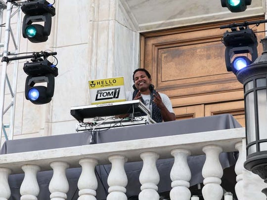 DJ Tom T entertained the crowd for the cocktail hour and afterglow event from a second story balcony during Fash Bash at the DIA on  Aug. 13, 2015.