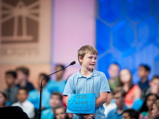 Liam Nyikos, 10, participates in round three of the preliminaries of the 2015 Scripps National Spelling Bee on May 27, 2015 at the Gaylord National Resort and Convention Center in National Harbor, Maryland.