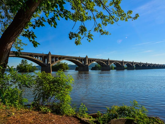 """""""The Veterans Memorial Bridge connecting Wrightsville on the York side, and Columbia in Lancaster County carries PA Route 462 across the Susquehanna River. Opened in 1930, the bridge parallels the piers that held the original bridge, burned by Union troops during the Civil War in 1863 to keep Confederates from crossing the river."""""""