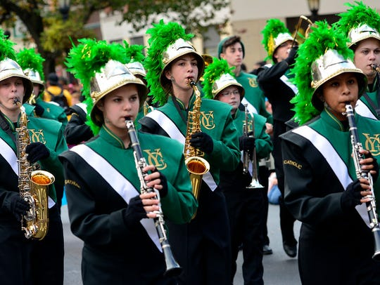 The York Catholic marching band performs during the