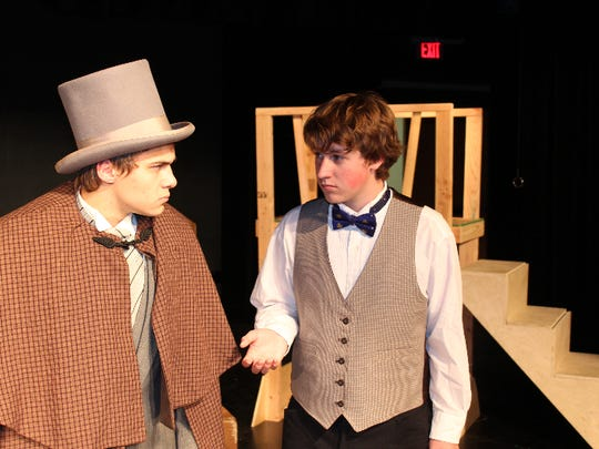 """scrooge: Michael Fender, left, as Ebenezer Scrooge and Darren Runyun as Bob Cratchit in Stayton High School's production of """"A Christmas Carol."""""""