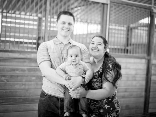 Aurora Godoy, one of 14 people killed in attacks in San Bernardino, is shown here  with her husband, James Godoy, and her 2-year-old son, Alexander Godoy.