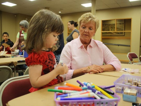 Kathy Elder and her granddaughter, Emelyne Lamb, 4, work on an ornament during Day at the Museum, featuring crafts by Good Garbage! at the Carnegie Center for Art & History in New Albany on Wednesday.