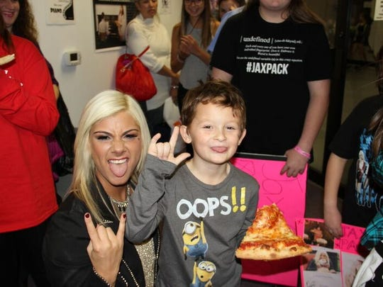 "During the filming of her music video for ""La La Land,"" Jax and a Jax Pack fan have some fun during a break."