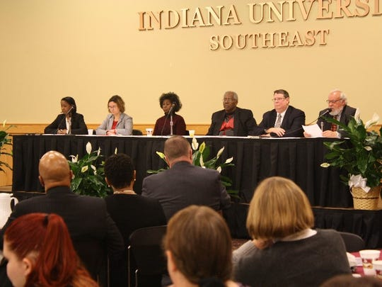 C. Martin Rosen, far right, leads a panel discussion