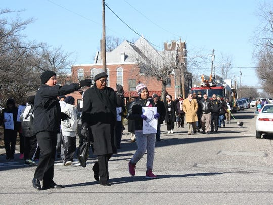 st Presbyterian Church pastor Don Summerfield directs walkers to the proper church entrance during the march/motorcade from the County Building to First Presbyterian Church for the 32nd Dr. Martin Luther King, Jr. Memorial Service on Monday.
