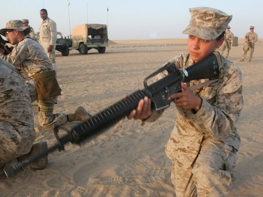 Military photos show former Corp. Laura Buckingham