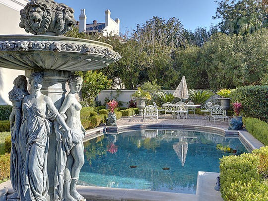 The historic home is surrounded by spectacular grounds and a stunning pool.