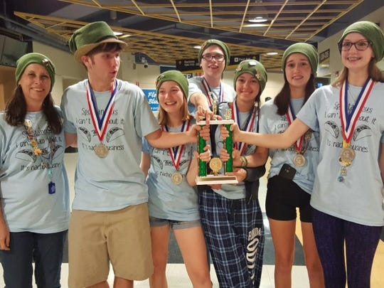 A six-member student team from Fort Myers celebrate with team coach after the state competition for Odyssey of the Mind, an international problem solving competition for students.  Shown from left are coach Kim Heindl, Kody Trent, Olivia Soum-Fontez, Addison Wagner, Nara Guanes, Danielle Heindl and Allison Smith.
