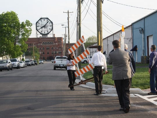 Town Council members and town officials remove the barricades to officially open the Court Avenue extension to Woerner Avenue in Clarksville.