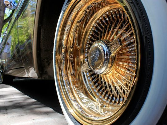 This May 22, 2016 photo shows an engraved spoked rim of one of the dozens of lowriders on display at the historic plaza in Santa Fe, as part of the city's Lowrider Summer celebration. The New Mexico History Museum and the New Mexico Museum of Art also are hosting exhibitions highlighting the lowrider culture.