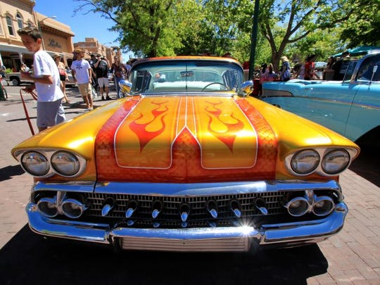 This May 22, 2016 photo shows one of the dozens of lowriders on display at the historic plaza in downtown Santa Fe, as part of the city's Lowrider Summer celebration, which includes a pair of exhibitions at the New Mexico History Museum and the New Mexico Museum of Art.