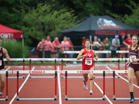 The lane for West Lafayette's Alex Deryn, who was badly injured in a car accident earlier this week, is empty during the 300 meter hurdles during the IHSAA 43rd annual girls track and field state finals, Robert C. Haugh Track and Field Complex at Indiana University, Bloomington, Ind., Friday, June 3, 2016. Deryn's fellow boys track athlete Christian Burns died in the accident.