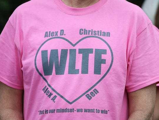 Shirts are worn by West Lafayette audience members