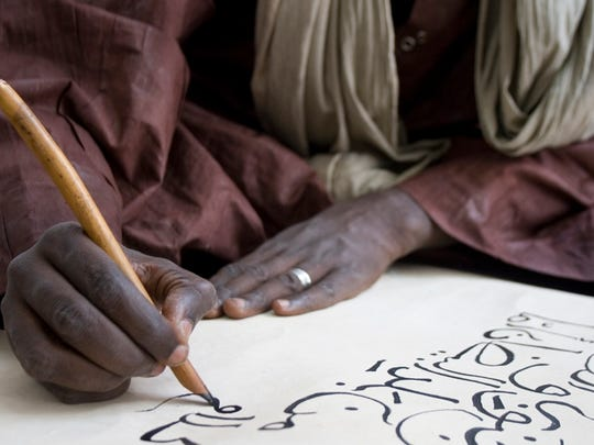 An untitled, 2013 photograph by Seydou Camara, Malian, born 1983. This is an Inkjet print.