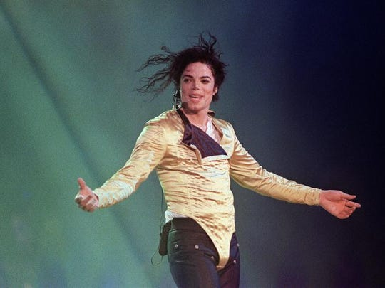 Michael Jackson performs in 1996. A large, private collection of Jackson collectibles are on display this weekend.