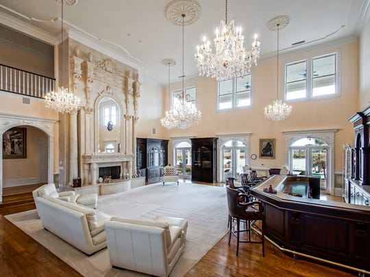 The living area boasts 20 foot ceilings and a world