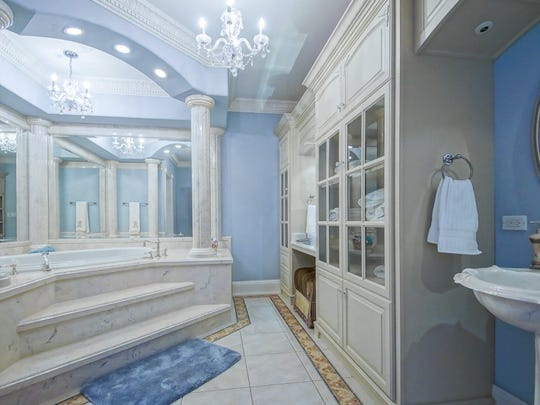 This master bath is fit for a queen.
