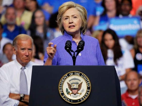 Democratic presidential nominee Hillary Clinton speaks at a campaign rally with Vice President Joe Biden.