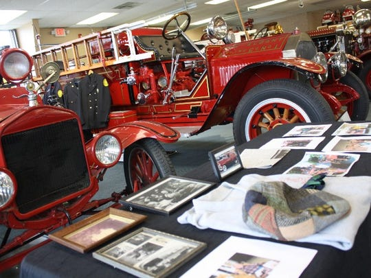 A table filled with memorabilia is displayed during the Vintage Fire Museum's Bicentennial Muster in downtown Jeffersonville on Saturday.