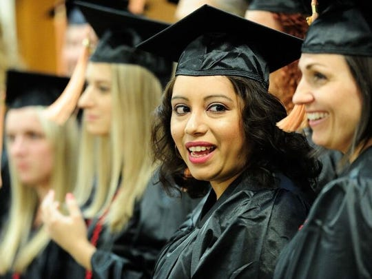 Chantel Marquez of Keizer smiles during her graduation ceremony Saturday, Oct. 1, 2016, at Mt. Scott Church of God in Portland. Marquez earned an associate's degree from the Breckinridge Nursing School at ITT Technical Institute before the for-profit school announced it would cease operating educational services.