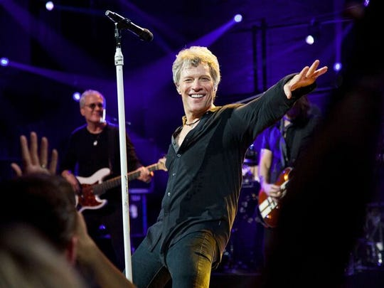 Jon Bon Jovi on the stage of hte Barrymore Theatre